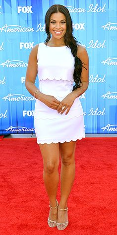 JORDIN SPARKS in scallop-edge white dress, drop earrings and strappy heels