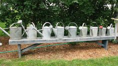 Galvanized watering can collection (part of a larger collection) by sunshinesyrie, via Flickr.