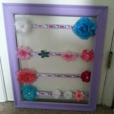Painted frame with ribbon to hold my daughters hair flowers