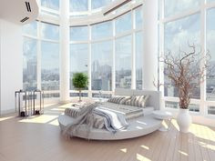 White bedroom with cathedral glass walls.