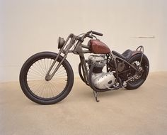 Sick Custom BSA bobber by Mr Mit on jockeyjournal.  Absolutely loving those front spokes and the girder front end.