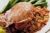 CAJUN STUFFED PORK CHOPS: Pork chops stuffed with sausage, onion, celery and green peppers  #Cajun #PorkChops