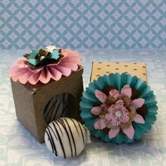 Chocolate Favor Box- These little chocolate candy boxes are a fantastic addition for any upcoming party! We love how Leica Forrest easily created these boxes by using Where Women Cook's Cake Pop Box die for these sweet candies, using dies by Tim Holtz to embellish and decorate them.