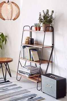 Max Wood Bookshelf, $189 | Largely known for its cheeky graphic tees and other made-for-college apparel, Urban Outfitters dedicates an enormous section for apartments that is surprisingly thorough.