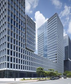 Image 1 of 11 from gallery of Shenzhen Software Industry Base / gmp architekten. Photograph by Christan Gahl Office Building Architecture, China Architecture, Architecture Panel, Commercial Architecture, Building Facade, Futuristic Architecture, Tower Building, Architecture Details, Mix Use Building