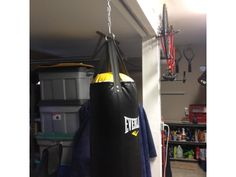 mount your punching bag in your garage gym TuffRail allows you to slide it out of the way when not in use. #homegym #garagegym