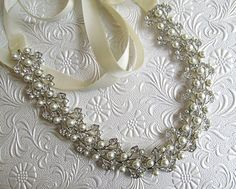 Wedding Headband Pearl and Crystal Wedding hair by MissJoansBridal, $42.50click here: https://www.etsy.com/listing/120688055/wedding-headband-pearl-and-crystal?ref=shop_home_active