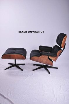 Eames Lounge Chair Ottoman In Walnut And Black Leather Available Http