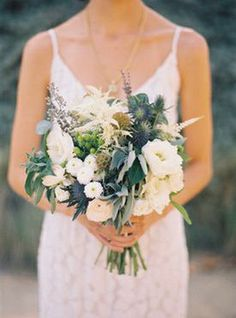 Garden roses, eryngium, greenery... Some natural looking teal floral