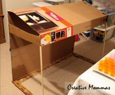DIY dessert table awning out of a cardboard box for a lemonade, candy, or any fun party!