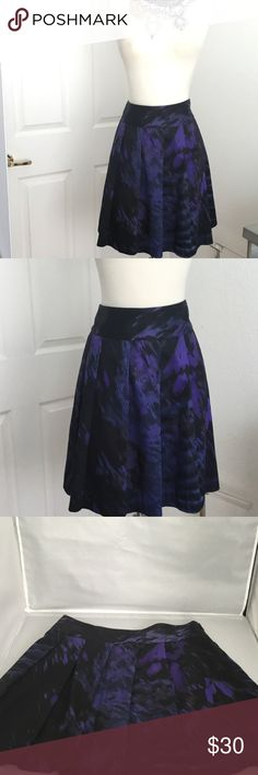 THEORY SKIRT THEORY BLACK AND PURPLE SKIRT. NEVER BEEN USED. ZIP ON SIDE. 2 SIDE POCKETS.LONG; 19 INCHES Theory Skirts Midi