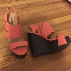Charlotte Russe wedges Coral wedges with dark brown to black wedge. Minor scuffs here and there as pictures but otherwise in great condition. Perfect pop of color for any outfit and super comfortable for a tall wedge. Also listed in my closet are the pieces I wore to complete the outfit! Charlotte Russe Shoes Wedges