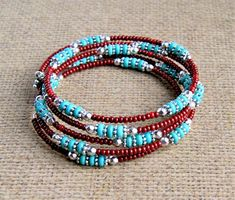 turquoise beaded bracelet, memory wire, boho bracelet, bohemian jewelry, gift for her this memory wire bracelet features turquoise disc beads surrounded by silver spacer beads and surrounded by contrasting brown seed beads. accented by a little silver flower charm. adjusts to fit most