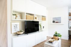 Our Multifunctional Ikea Besta TV Wall + Storage System is part of Living Room Storage Besta - lounge space, the most popular questions all pointed to the tv wall we created that provides lots of storage for our homeschool needs Like I mentioned in… Living Room Storage, Ikea Wall Storage, Living Room Cabinets, Ikea Living Room, Wall Storage, Wall Cabinets Living Room, Living Room Diy, Wall Storage Unit, Wall Storage Systems