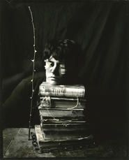 """Lauren E. Simonutti, Eyes Taped Shut, 2010 From the 8 Rooms 7 Mirrors 6 Clocks 2 Minds and 199 Panes of Glass series 5 x 4"""" toned gelatin silver contact print"""