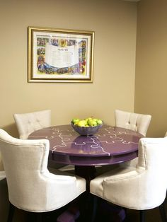 Designers Notes A unique puzzle motif is painted on the purple game table. Classic chairs surround the table for comfy game playing.