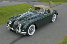 1959 Jaguar XK150, English racing green.