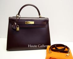 http://www.haute-gallery.com/    Hermes Kelly Sellier 32cm Raisin Box Leather Gold Hardware    Model: H_10605    Material: Box leather    Hardware: Gold hardware    Accessories: Usually ships in 5-7 business days.