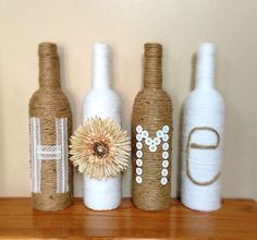 Look Over This Wine Bottle Decor A set of 4 wine bottles – 2 wrapped in twine and 2 wrapped in white yarn – that spell HOME. Custom colors or words are The post Wine Bottle Decor A set of 4 wine . Wine Bottle Art, Diy Bottle, Wine Bottle Crafts, Beer Bottle, Home Crafts, Diy Home Decor, Diy And Crafts, Twine Crafts, Room Decor