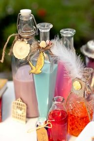 Mad-Hatter tea party (Hilary Cam Photography) - cool idea, put funky drinks in decorated bottles