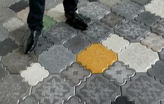 These concrete tiles are FANTASTIC! I wonder if I could do this and use some sort of mold, baking maybe? Ornate cake pans? I need to replicate this...!!