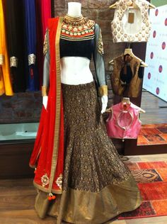 Black maharani neck and lehenga with red dupatta  Like bottom skirt design