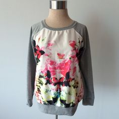 Floral sweatshirt with baseball style sleeves Preowned and in excellent condition. Size medium.  Measurements: underarm to underarm flat across is approximately 21 inches. Back of neck to bottom of hem is approximately 22 1/2 inches. No material tag- front panel is a polyester like material and the rest is probably a cotton/polyester/spandex blend. Like a lightweight sweatshirt without the fuzzy inside. If you need more info please ask! Sweaters Crew & Scoop Necks