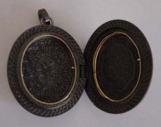 VICTORIAN vulcanite  plain smooth oval locket with intricate design inside, 1-3/4.