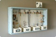 vintage jewelry storage  wooden crate, wooden spools, little boxes for catching extras, possibly in a walk-in closet