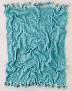 This Turquoise Pyper Pom Pom Throw Blanket is a super soft wool blend throw blanket that's perfect to curl up with. Finished with pom detailing we love. Top off a couch, chair or bed, or even…