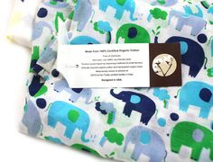 100% Certified organic cotton muslin soft swaddle blanket cloth set - single layer, oversize, durable, lightweight, non-toxic formulation, pesticide free, soft, naturally absorbent and breathable.  Screen-printed on one side, unique and charming prints, sustainable, Eco-friendly product.  Set of 2 (1 in each design), size of each piece is 47 x 47 inches, oversize.  Fabric becomes softer by each wash.  Ethically sourced organic cotton, product woven and stitched at a GOTS and Fair-Trade…