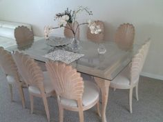 Carved wood shell Dining room table and chairs