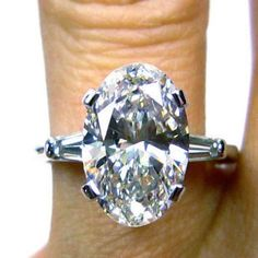 A Classic 4CT Oval Cut Russian Lab Diamond Engagement Ring with Baguettes