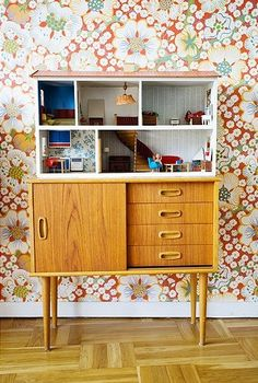 retro cabinet with dollhouse, also cool because you can store doll pieces and furniture in the drawers underneath