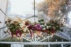 We love installations, the lusher and more vibrant the better. The pampas grass adds a luxe, boho touch.