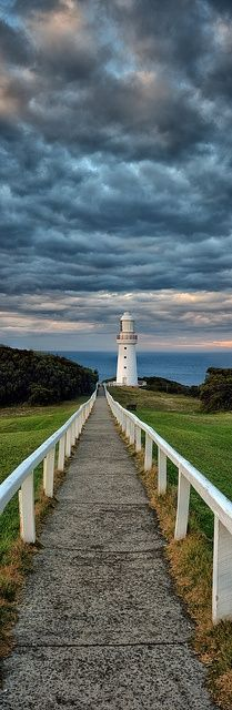 Walkway leading to a small lighthouse by the shore - Long, Tall, Vertical Pins.