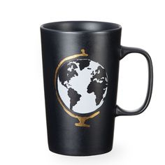 A ceramic coffee mug with an artistic globe and matte black exterior, part of the Dot Collection.