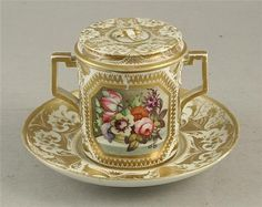 <b>An early 19th century Derby chocolate cup, saucer and cover,</b></i> with two painted panels of baskets of flowers on a ledge, within elaborate gilt borders, painted mark, <i>as found</b></i>