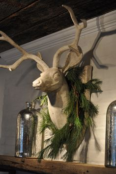 did this for my mantel this year, added snowflakes to the greenery!