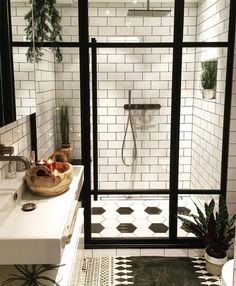 Shower glass screen with matte black accents.