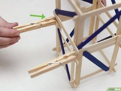 How to Build a Popsicle Stick Tower. Popsicle stick towers are a common engineering project to be assigned in school.Your assignment may have various criteria for height, weight, and number of popsicles, but this guide will give you a. Engineering Projects, Wood Glue, Popsicle Sticks, Stem Activities, Diy Wood Projects, Popsicles, Tableware, Building, Pictures