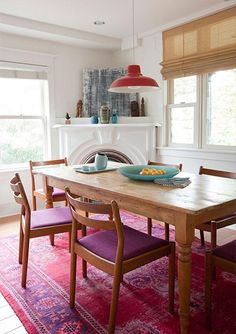 Bright rugs in the dining room.