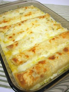 White Chicken Enchiladas -- 8 flour tortillas, 2 cups cooked, shredded chicken (I used half of a rotisserie chicken), 2 cups shredded Monterey Jack cheese, 3 Tbsp butter, 3 Tbsp flour, 2 cups chicken broth, 1 cup sour cream, 1 (4 oz) can diced green chilies
