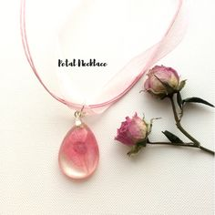 Delicate  Handmade Item  * Material: Real Flower Petal Pendant in Resin attached to a beautiful Pink Organza Ribbon & Cotton Necklace Cord.     * Size:  The Oval Pendant is 25mm long  The Pink Organza Cord Necklace is 18inches (45cm)    This Beautiful Real Floral Pendant Will Make You Stand Out From The Crowd!    Pretty Dried Flower Petal that you have the power to freeze forever in time! A Fabulous Treat For Yourself Or a Gift For Someone Special!     * ABOUT HANDMADE JEWELLERY:   Because…