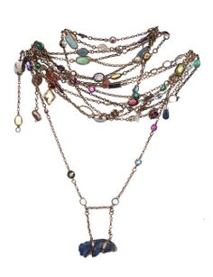 Necklace: Long gold chain set with wide variety of gemstones, coins, figures.  1900-1980, NYHS Object Number INV. 12670.