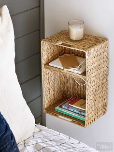Jenna got creative with a $10 woven basket, adding shelves to turn it into a bedside table that incorporates a charging station (cords slip through holes cut in the adjacent wardrobe and into an electric outlet).