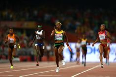 World Athletics Championships 2015: day eight – in pictures   Sport   Shelly-Ann Fraser-Pryce crosses the finish line to win gold in the women's 4x100m relay final