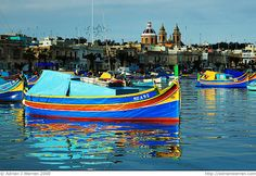 I, Luzzu    Here we see a traditional brightly coloured Maltese fishing boat; the Luzzu, at rest in Marsaxlokk harbour, Malta.    The boat really stands out from the background because the sun has only just broken through the clouds, and is only falling on the boats near to me; the harbour behind is still shaded by the clouds. I really like the effect; I hope you do too!    There are three types of boat unique to Malta, but only two of those are fishing vessels; the Luzzu and the Kajjik. How…