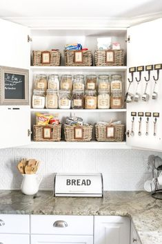 Pantry Cabinet Organization and Printable Labels A cabinet gets a drastic organization makeover using inexpensive IKEA jars / baskets, hanging storage, and a free pantry label printable set. Smart Kitchen, Kitchen On A Budget, Diy Kitchen, Kitchen Decor, Kitchen Ideas, Kitchen Pantry, Kitchen Hooks, Kitchen Labels, Kitchen Storage Baskets