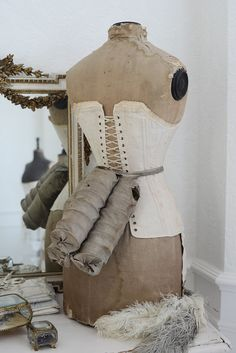 Antique mannequin corset and triple coil bustle by WhiteandFaded